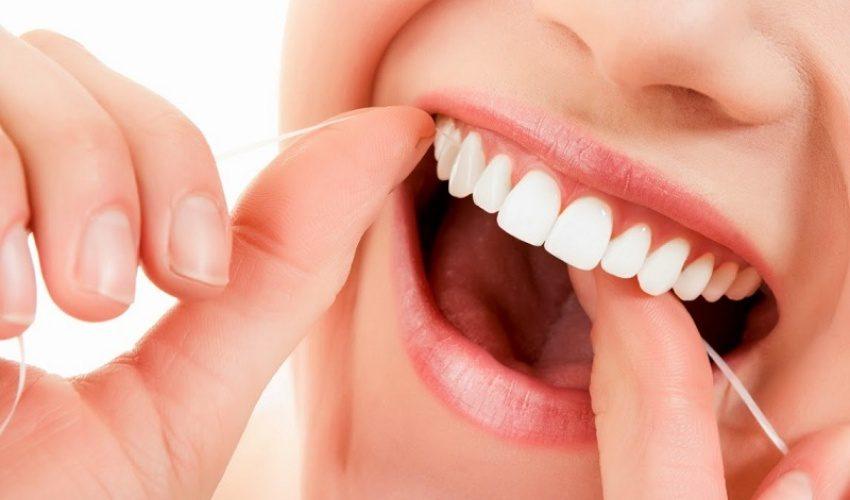 usar el hilo dental